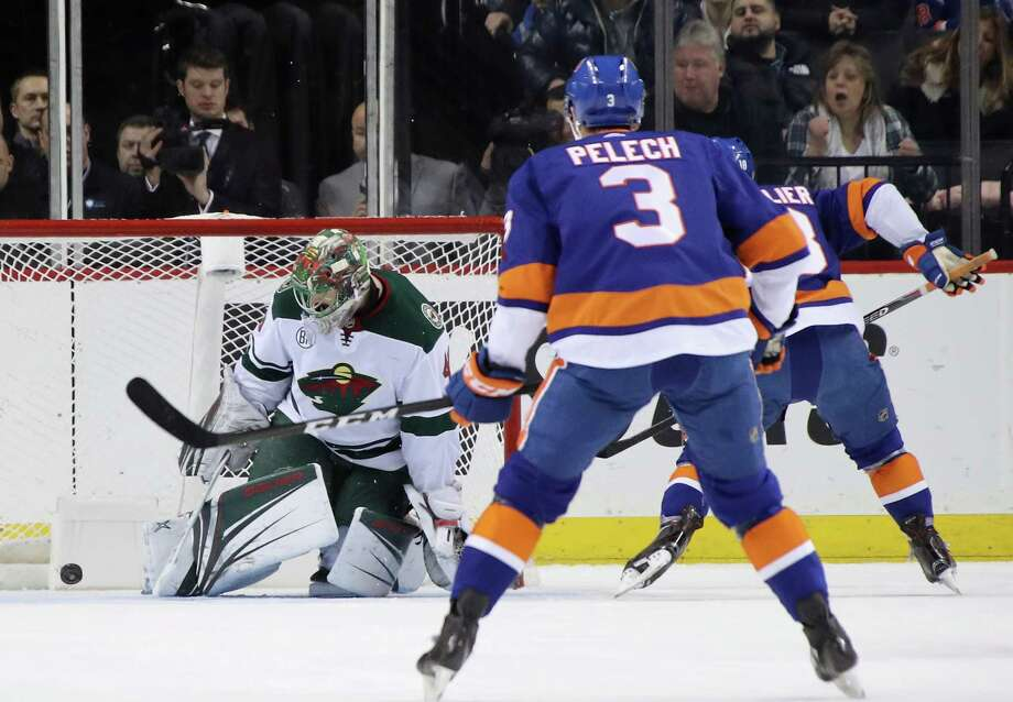 NEW YORK, NEW YORK - FEBRUARY 10: Anthony Beauvillier #18 of the New York Islanders (r) celebrates a first period goal against Devan Dubnyk #40 of the Minnesota Wild at the Barclays Center on February 10, 2019 in the Brooklyn borough of New York City. (Photo by Bruce Bennett/Getty Images) Photo: Bruce Bennett / 2019 Getty Images