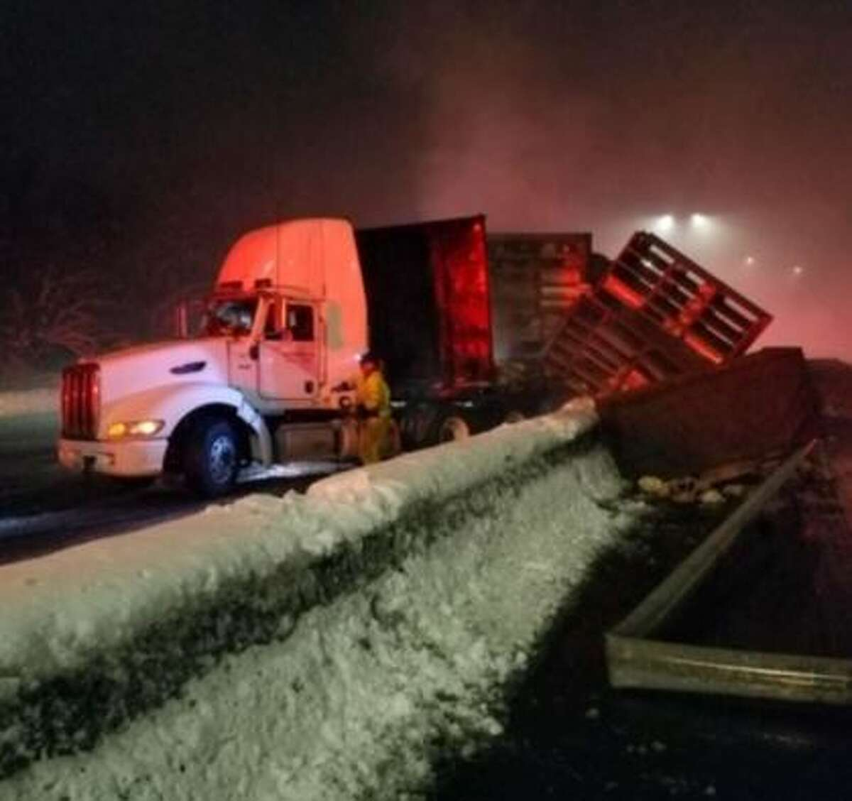 A semi-trailer tractor transporting live chickens crashed into the center barrier Monday morning on Interstate 5 in Olympia. The driver was uninjured. Some chickens were killed in the crash, others were injured and others ran free.