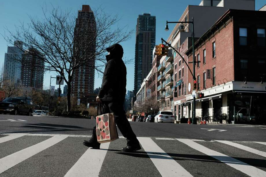 People walk through the Long Island City neighborhood on Feb. 9, 2019, in Queens, N.Y. According to recent reports, Amazon is reconsidering its plan to locate one of its new headquarters in Long Island City due to the opposition the project has received locally. Photo: Spencer Platt / Getty Images / 2019 Getty Images