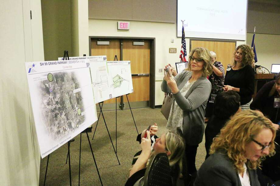 Residents get a closeup look at the proposed maps for the new SH 99 that will drastically affect the Liberty County area. Photo: David Taylor / Staff Photo