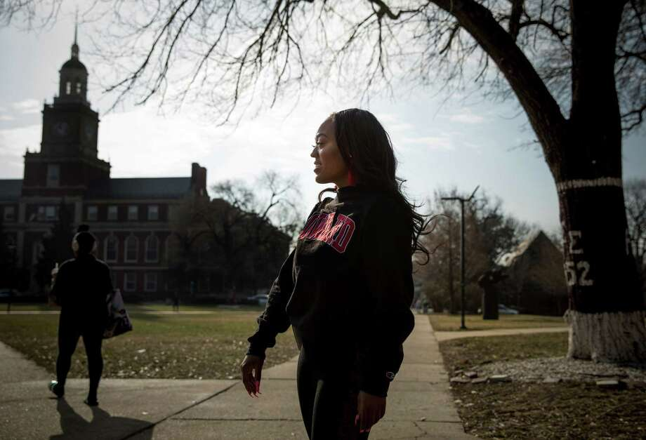 Mya Thompson, a 25-year-old senior at Howard University, walks to class on Wednesday, Feb. 6, 2019. Thompson is a recipient of a gift from the Alfred Street Baptist Church, which donated $100,000 to Howard University students to clear them of their student debt. Photo: Photo For The Washington Post By Evelyn Hockstein. / Evelyn Hockstein