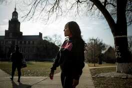 Mya Thompson, a 25-year-old senior at Howard University, walks to class on Wednesday, Feb. 6, 2019. Thompson is a recipient of a gift from the Alfred Street Baptist Church, which donated $100,000 to Howard University students to clear them of their student debt.