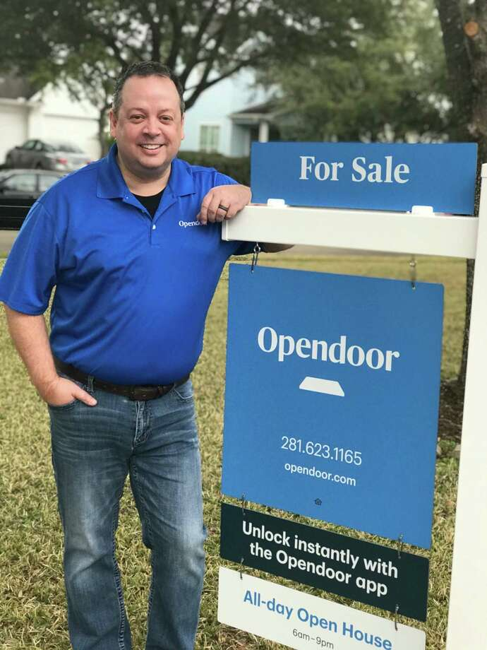 Jason Cline, general manager of Opendoor Houston, stands outside of a home the iBuyer bought directly from a homeowner and is listing on the market itself. Opendoor now also offers title and escrow services and home loans, part of a trend toward bundling homebuying services. Photo: Opendoor