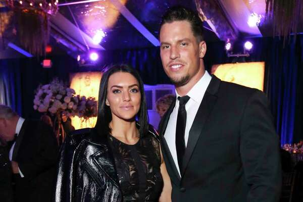 EMBARGOED FOR SOCIETY REPORTER UNTIL FEB. 11 Megan and Brian Cushing pose for a photograph at the 2019 Ballet Ball at the Houston Ballet Center for Dance on Saturday, Feb. 9, 2019, in Houston.