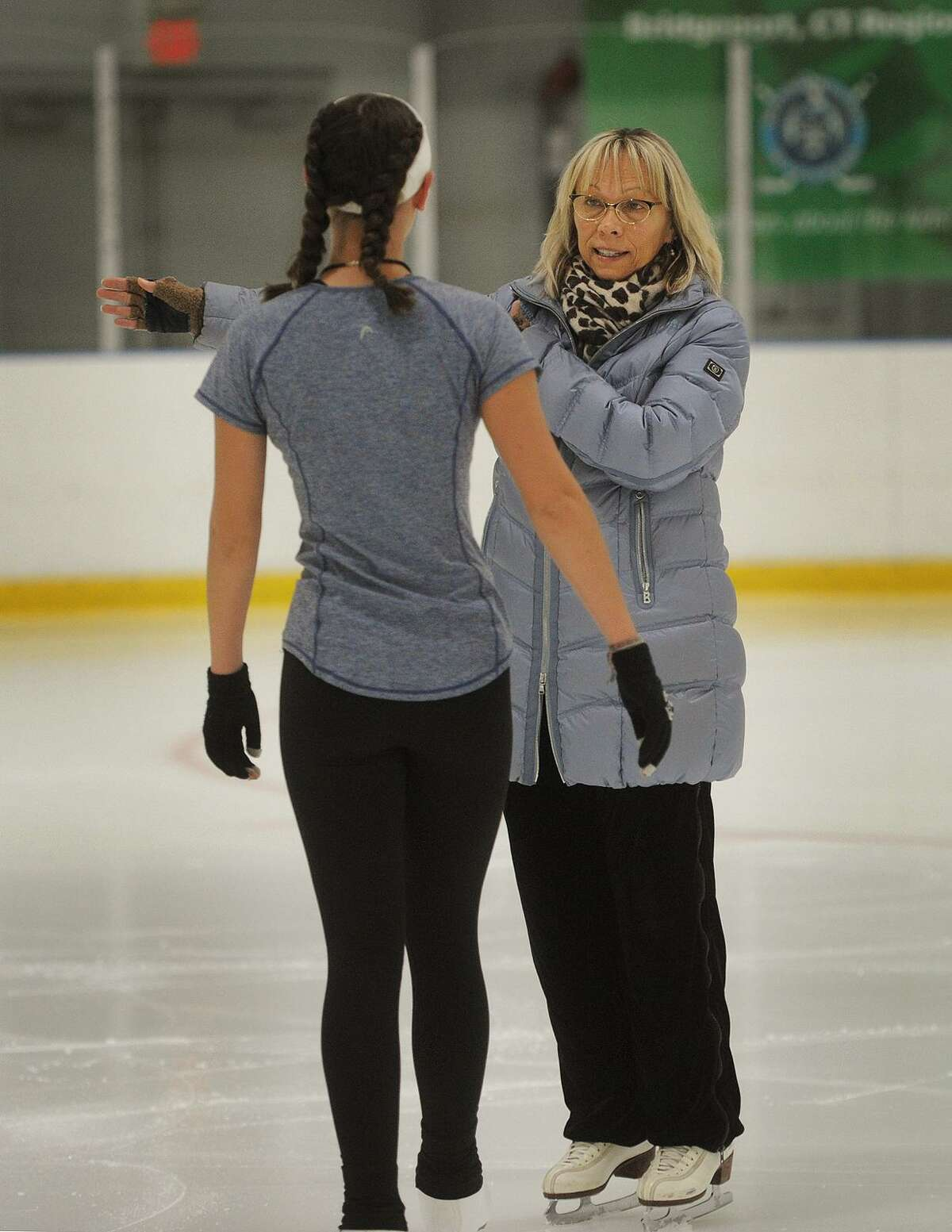 Wonderland of Ice owner and Sacred Heart University figure skating coach Lisa Fedick works with skater Alexa Rodrigues at the rink in Bridgeport, Conn. on Thursday, September 27, 2018.