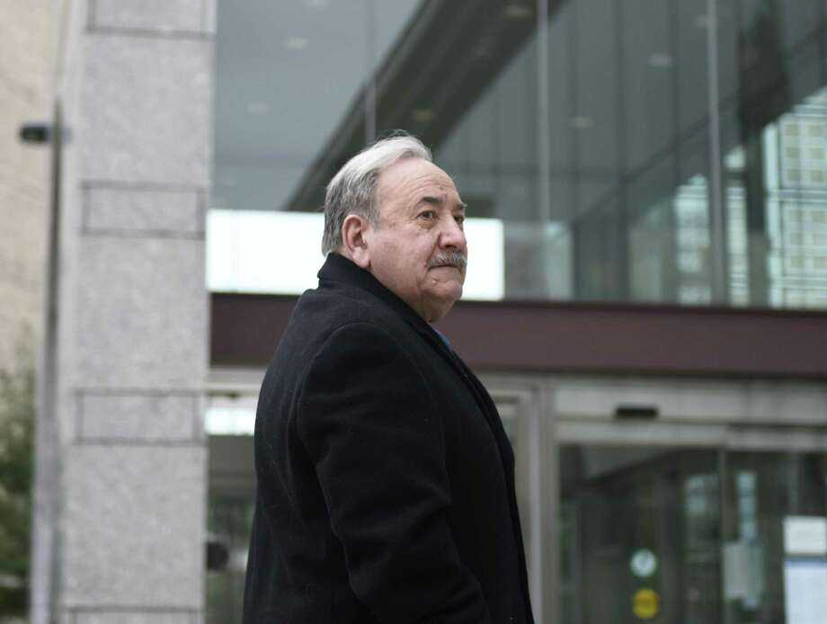 Former Stamford Democratic City Committee Chairman John Mallozzi enters the Connecticut Superior Court in Stamford, Conn. Monday, Feb. 11, 2019. Mallozzi is being charged with 14 counts each of filing false statements and second-degree forgery in an identity-theft scheme involving absentee ballots stemming from the 2015 municipal election. Photo: Tyler Sizemore / Hearst Connecticut Media / Greenwich Time