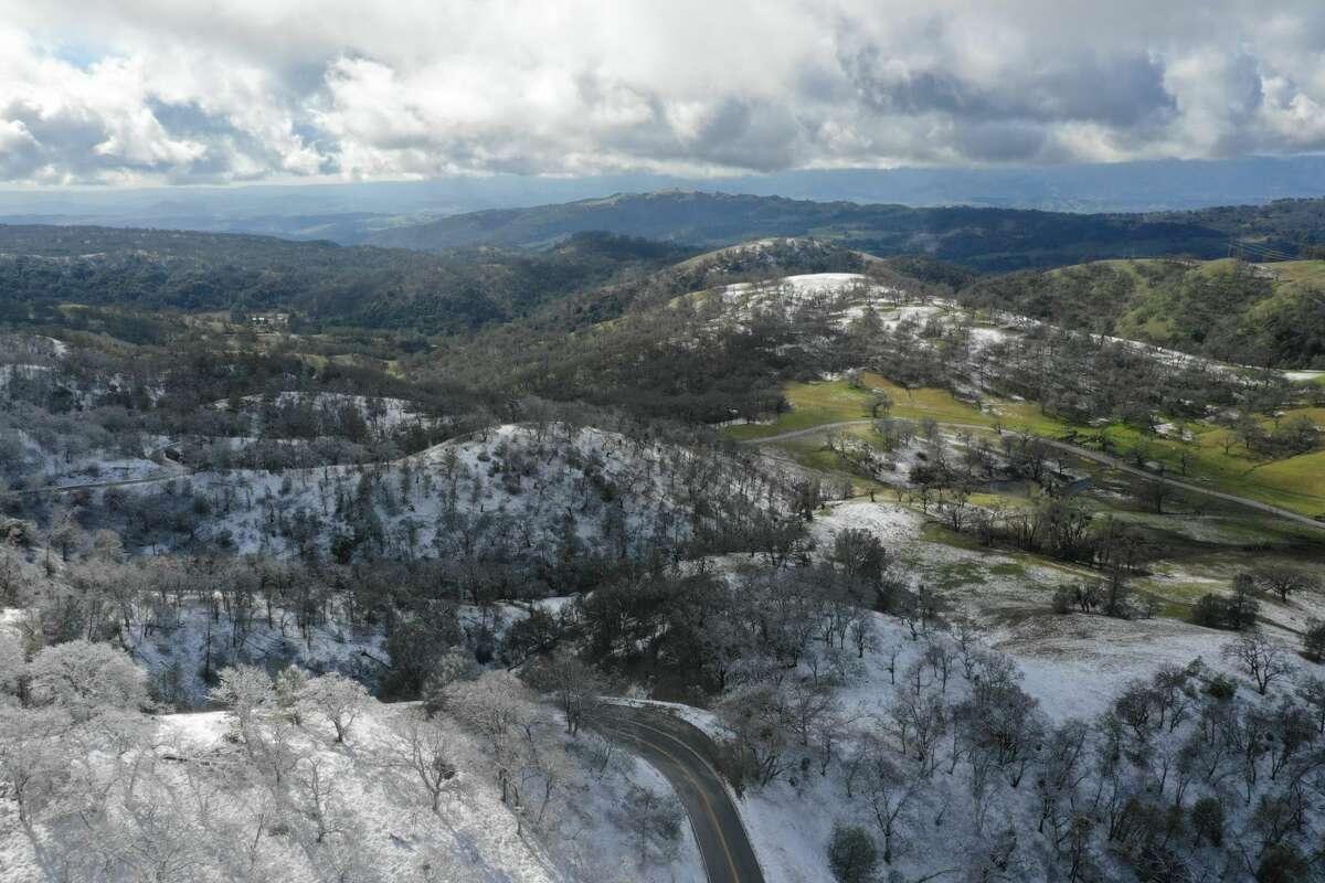 FILE - Drone photo of snow on Mount Hamilton southeast of San Jose on Sunday, Feb. 10, 2019.