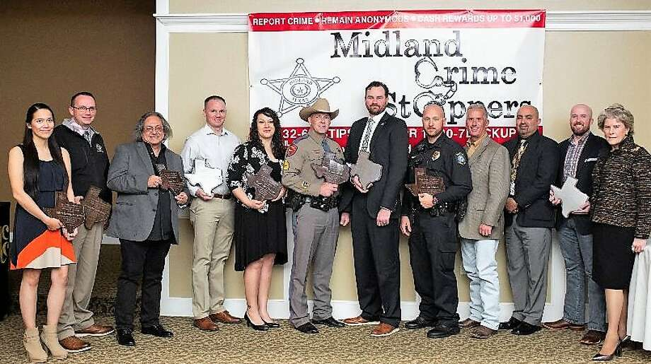 Midland Crime Stoppers annual awards banquet was Jan. 31 at the Petroleum Club. Winners are: Midland Police Department Officer Cassandra Carrasco, from left, Midland County Fire Marshal Office Investigator Justin Bunch, Danny Barrera, Midland Fire Department Fire Marshal's Office Investigator Toby Bunch, Midland County Sheriff's Office Deputy Jane Aranda, Department of Public Safety Sgt. Jon Shock, Deputy U.S. Marshal Donald Hughes, Midland ISD Police Department Officer McClendon, Lee High School Assistant Principal Gregg Devault, LHS Assistant Principal Paul Hidalgo and past MFD Investigator John Buck. The keynote speaker was U.S. Marshal Susan Pamerleau, far right. Photo: Courtesy Photo