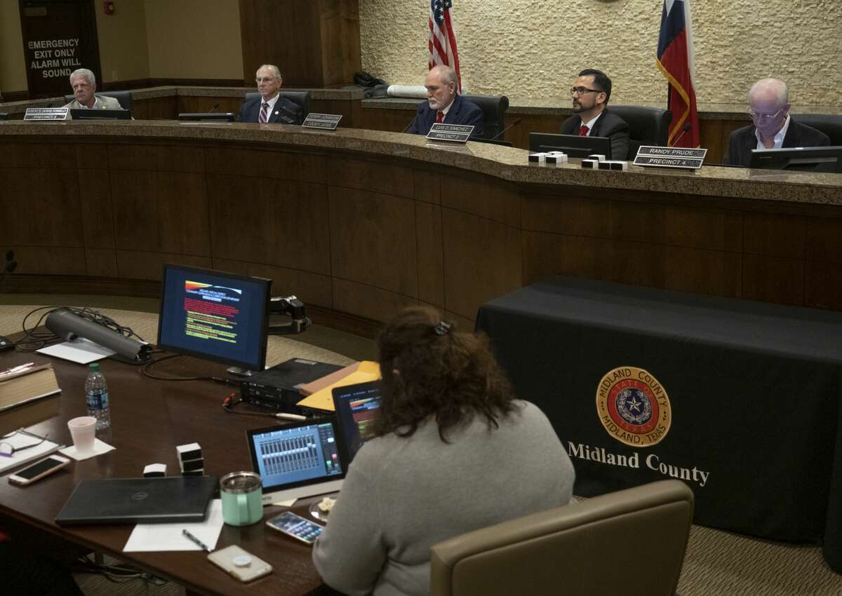 FILE PHOTO: Midland County Judge Terry Johnson, with Commissioners Scott Ramsey, Robin Donnelly, Luis Sanchez and Randy Prude, listen to presentations to the court 02/11/2019. Tim Fischer/Reporter-Telegram