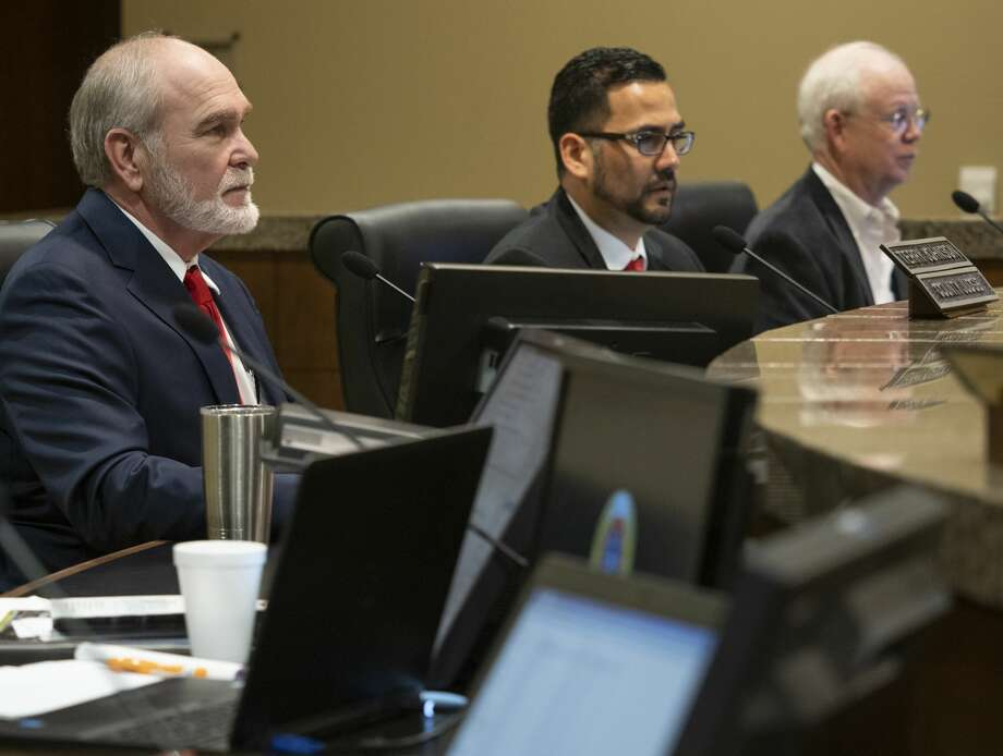 Midland County Judge Terry Johnson, with Commissioners Luis Sanchez and Randy Prude, as well as other commissioners, listen to presentations to the court Feb. 02, 2019. Midland County Commissioner Luis Sanchez has submitted petitions to the Texas Secretary of State's office for election inspectors to be present at two upcoming elections. Photo: Tim Fischer