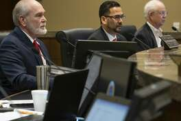 Midland County Judge Terry Johnson, with Commissioners Luis Sanchez and Randy Prude, as well as other commissioners, listen to presentations to the court 02/11/2019. Tim Fischer/Reporter-Telegram