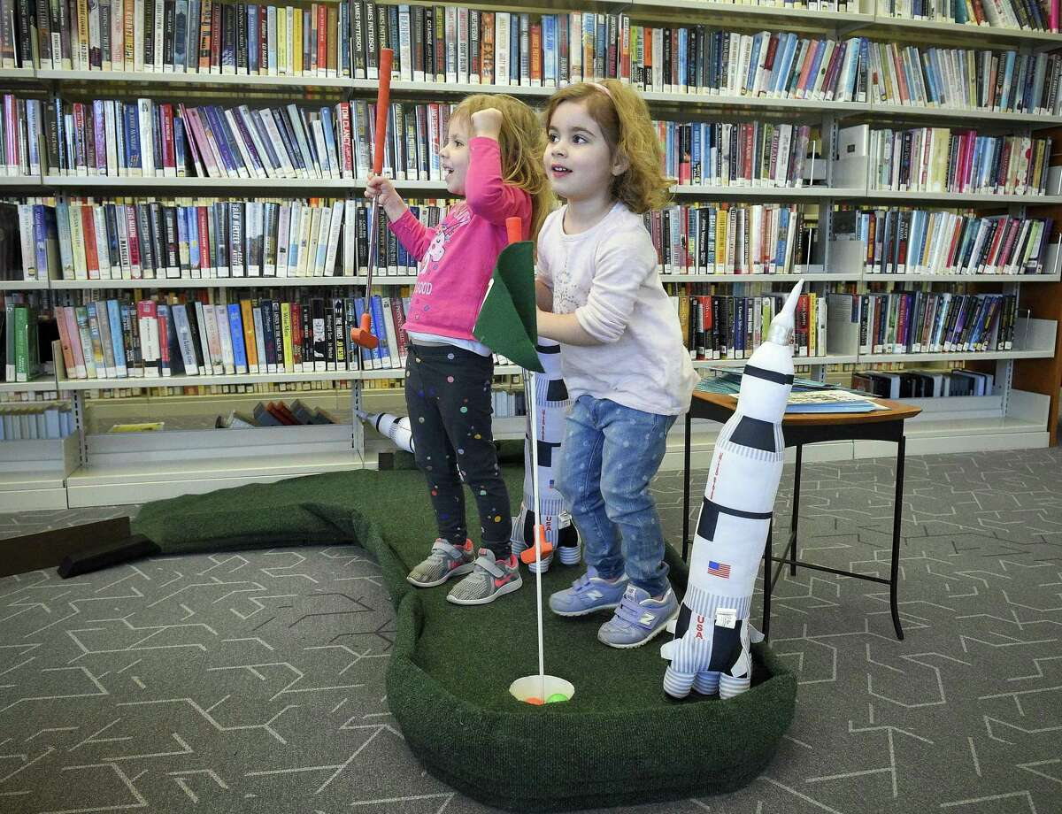 Reese Delisle of Yonkers, NY and her friend Riley Schoch of Stamford celebrate together making parr at the 12th hole in a round of Mini-golf during a fund raising event at the Harry Bennett Branch of the Ferguson Library on Saturday, Feb. 9, 2019 in Stamford, Connecticut.