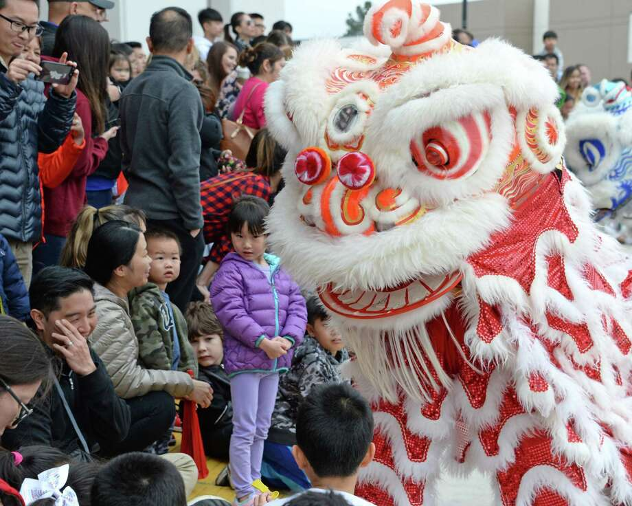 LunarFest performers from Lee's Golden Dragon and Lion Dance Association interact with the crowd at Katy Asian Town on Sunday, February 10, 2019. Photo: Craig Moseley, Houston Chronicle / Staff Photographer / ©2019 Houston Chronicle