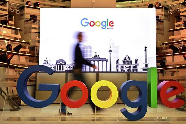 A technician passes by a logo of US internet search giant Google during the opening day of a new Berlin office of Google in Berlin on January 22, 2019. (Photo by Tobias SCHWARZ / AFP)TOBIAS SCHWARZ/AFP/Getty Images
