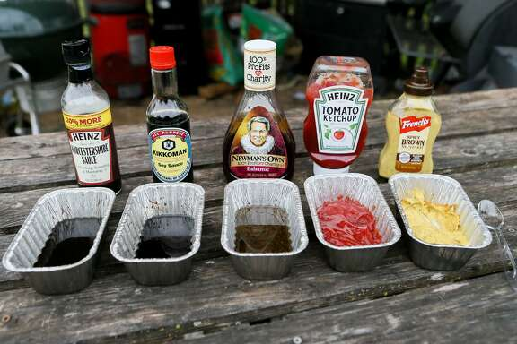 Five of the smoked sauces Chuck Blount tested to see how they taste after being smoked for two hours. From left: Heinz Worcestershire Sauce, Kikkoman soy sauce, Newman's Own balsamic vinaigrette, Heinz tomato ketchup and French's spicy brown mustard.