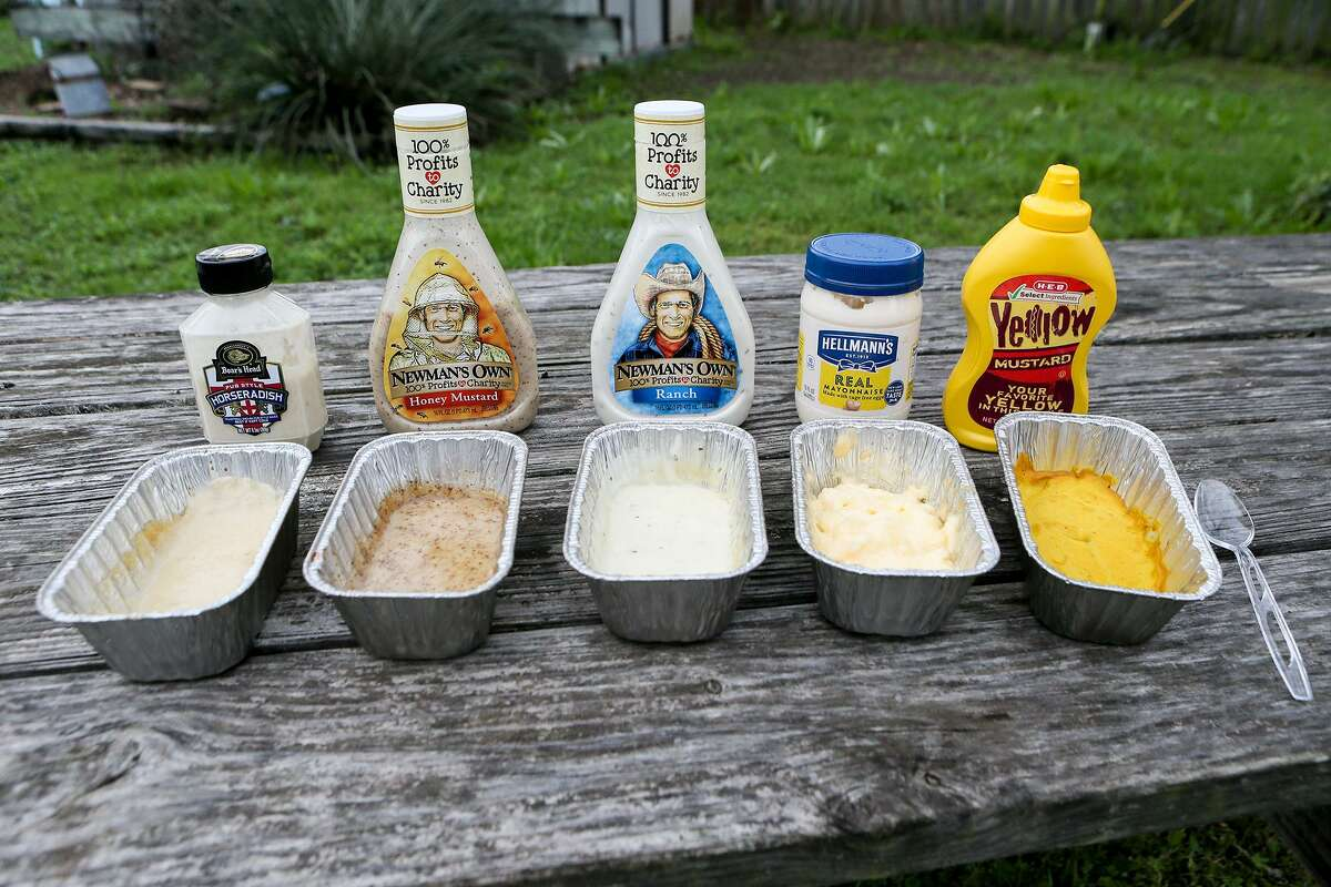 Five of the smoked sauces Chuck Blount tested to see how they taste after being smoked for two hours. From left: Boar's Head horseradish, Newman's Own honey mustard dressing, Newman's Own ranch dressing, Hellmann's mayonnaise and H.E.B. Yellow Mustard.