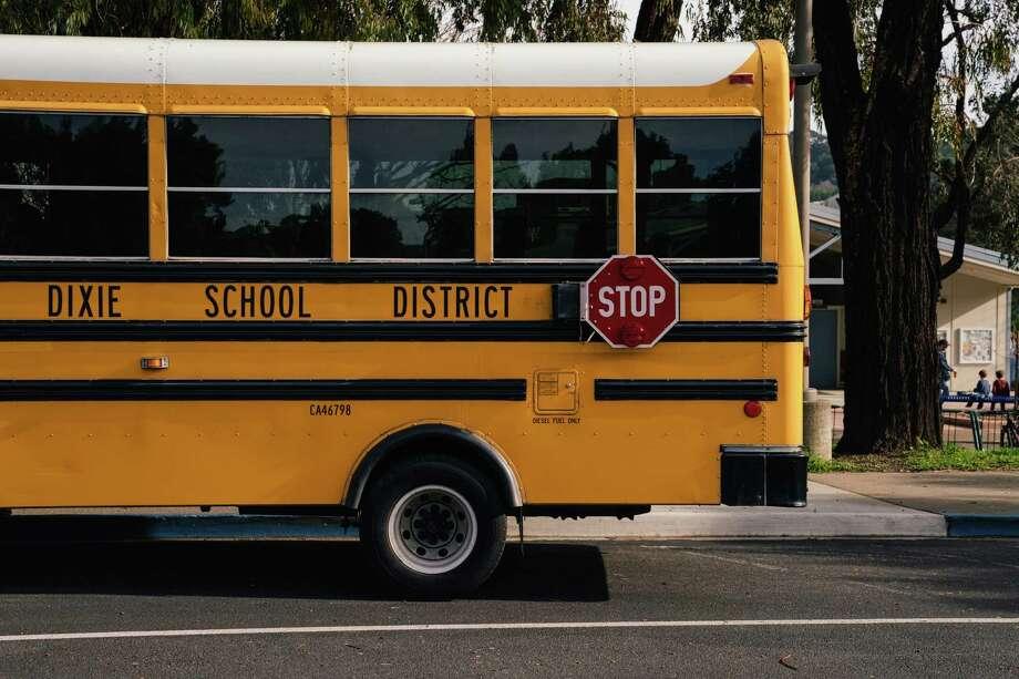 A Dixie Elementary School school bus waits the parking lot of the Dixie Elementary School in San Rafael, Calif. Photo: Photo For The Washington Post By Mason Trinca / Mason Trinca