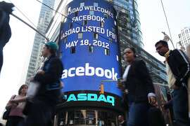 LE - JULY 31:  Shares of Facebook rose above the $38 initial public offering price July 31, 2013 for the first time since it went public in May of 2012. NEW YORK, NY - MAY 18:  The Nasdaq board in Times Square advertises Facebook which is set to debut on the Nasdaq Stock Market today on May 18, 2012 in New York, United States. The social network site is set to begin trading at roughly 11:00 a.m. ET and on Thursday priced 421 million shares at $38 each. Facebook, a Menlo Park, California based company, will have a valuation exceeding $100 billion.  (Photo by Spencer Platt/Getty Images)