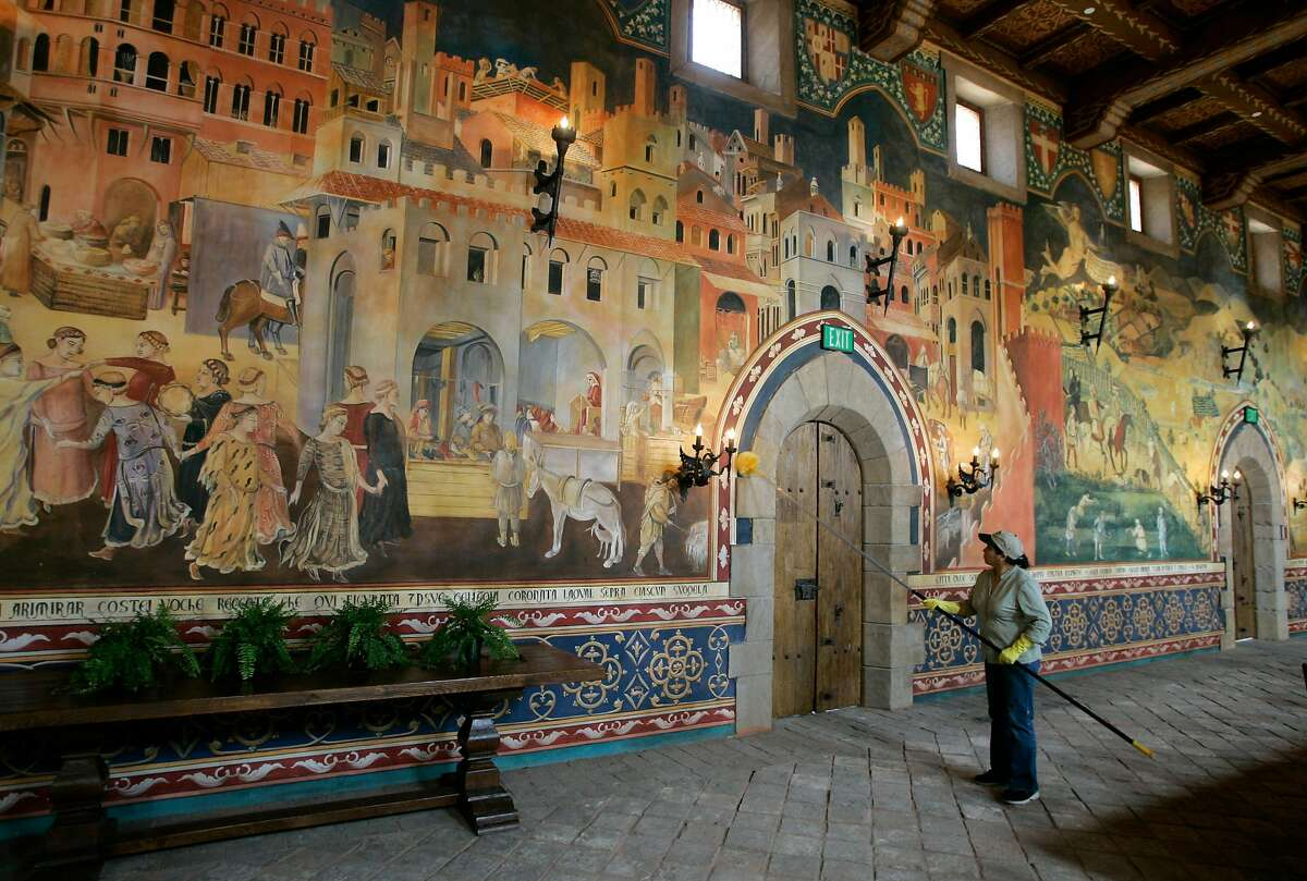 ** FOR IMMEDIATE RELEASE **A worker cleans a wall inside the Great Hall dining room at the Castello di Amorosa in Calistoga, Calif., May 18, 2007. Daryl Sattui set out to build a modest, 8,500-square-foot winery. Millions of dollars and 120,000 square feet later he's king of a wine country castle complete with drawbridge, dungeons and nifty little slots for the old boiling oil trick. (AP Photo/Eric Risberg)