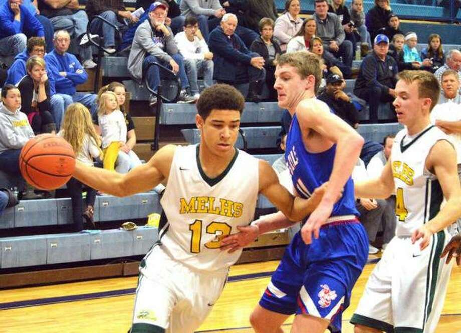 Metro-East Lutheran sophomore AJ Smith, left, drives to the basket during the second quarter of a Dec. 26 game against Nashville at the Mater Dei Christmas Tournament. Photo: Scott Marion/Intelligencer