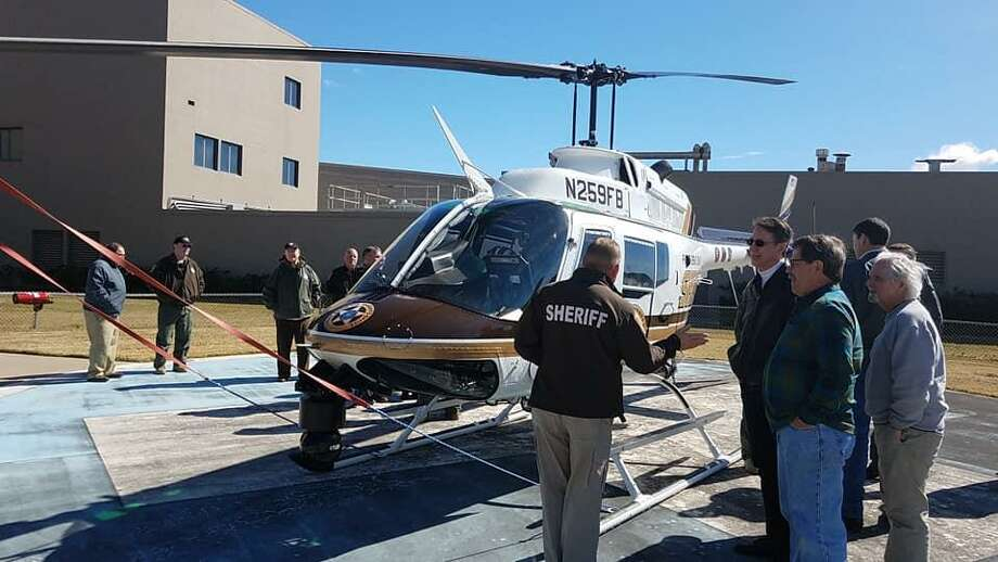 Shown here, Fort Bend County Sheriff Troy Nehls educations members of the Richmond Rotary Club on one of the department's helicopters. Photo: Richmond Rotary Club