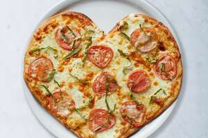 California Pizza Kitchen restaurants are offering heart-shaped pizzas.
