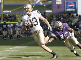 Wide Receiver Jeff Samardzija #83 of the Notre Dame Fighting Irish scores a touchdown in the fourth quarter against Roy Lewis #28 of the Washington Huskies on September 24, 2005 at Husky Stadium in Seattle, Washington. (Photo by Otto Greule Jr/Getty Images)