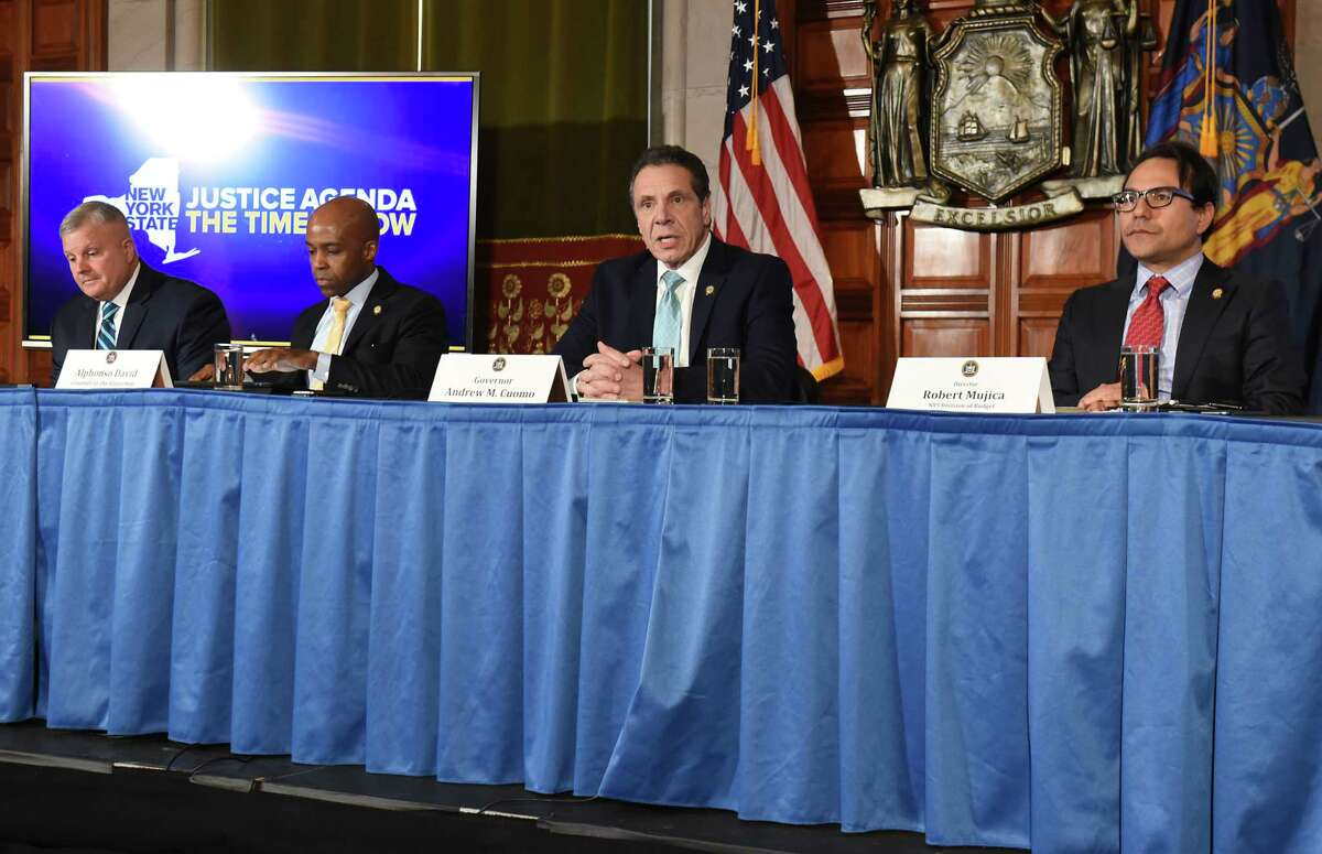 Governor Andrew Cuomo, second from left, announces he will be meeting with President Donald Trump about the federal administration?•s state and local tax (SALT) policy during a press conference at the New York State Capitol on Monday Feb. 11, 2019 in Albany, N.Y. (Lori Van Buren/Times Union)