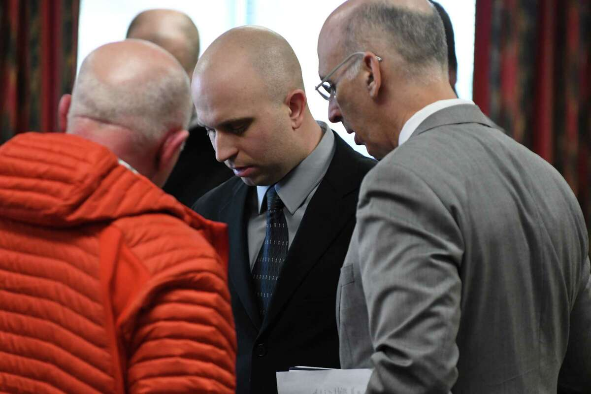 Eric Rosenbrock, center, speaks with family members and his attorney, Kurt Mausert, right, at Wilton Town Court where he was charged with manslaughter in death of his wife on Monday, Feb. 11, 2019, in Wilton, N.Y. The Lake George science teacher, who allegedly shot and killed his wife in their Corinth home, went to the local State Police barracks on Monday. (Will Waldron/Times Union)