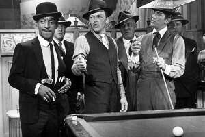 "Sammy Davis, Jr. (left), Frank Sinatra and Dean Martin in 1964's ""Robin and the Seven Hoods."""