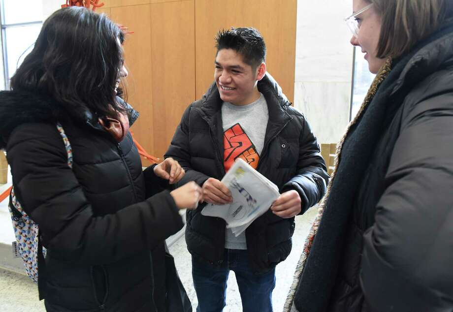 Farmworker Crispin Hernandez, center, talks women from the New York Cilvil Liberties Union after the Albany Supreme Court heard his oral arguments in a case against the state and the Farm Bureau in the Robert Abrams Building on Monday Feb. 11, 2019 in Albany, N.Y. Hernandez is suing the state and the Farm Bureau for the exclusion of farmworkers from the right to organize and collectively bargain without fear of retaliation like other workers. (Lori Van Buren/Times Union) Photo: Lori Van Buren, Albany Times Union / 20046163A
