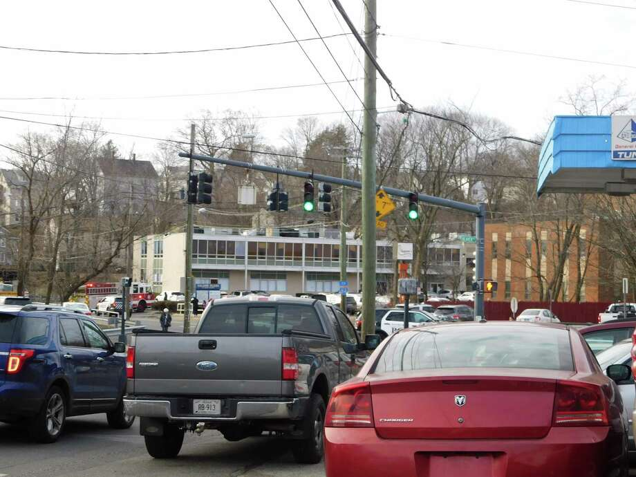 Traffic is redirected around the area of 131 West Street, where a vehicle hit a telephone pole Monday, Feb. 11. Photo: Kendra Baker