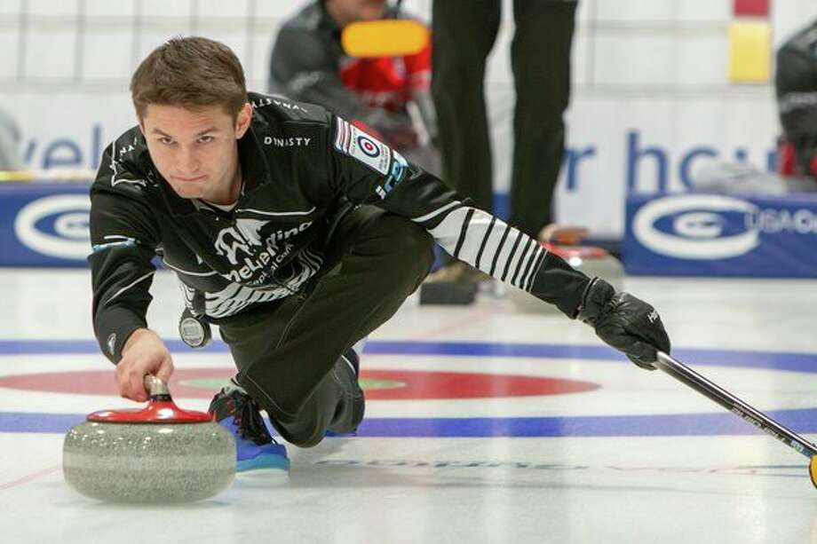 Midland's Sam Strouse competes on Saturday for Team Strouse at the USA Curling National Championships in Kalamazoo, which continue through this coming Saturday. (Bruce Lipsitt/for the Daily News)