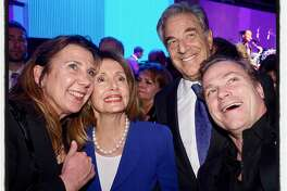 Rep. Nancy Pelosi and her husband, Paul (center, pose for a selfie with Gino Gallo and her husband, Jean-Charles Boisset at SFJazz gala. Jan. 31, 2019.