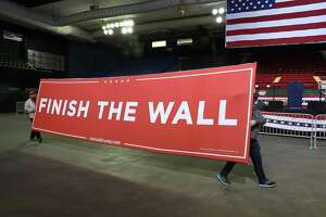 EL PASO, TEXAS - FEBRUARY 11: Workers carry a sign that reads 'Finish the Wall' as they prepare for the arrival of President Donald Trump for a rally at the El Paso County Coliseum on February 11, 2019 in El Paso, Texas. Trump is expected to ask Congress to allocate funds for more wall to be built along the U.S./Mexico border as the Democrats in Congress ask for money for other border security measures. (Photo by Joe Raedle/Getty Images)