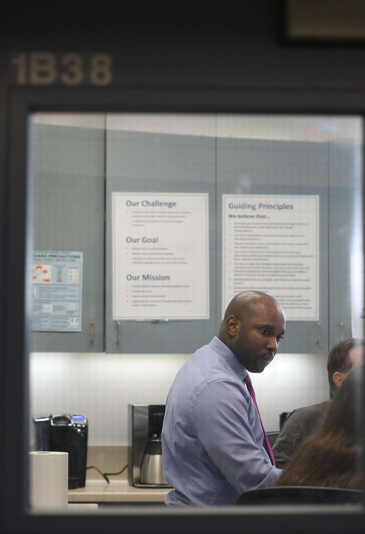 Anton Bland, medical director Psychiatric Emergency Services, works with staff during a staff meeting at Psychiatric Emergency Services at Zuckerberg San Francisco General on Monday, February 11, 2019 in San Francisco, Calif.