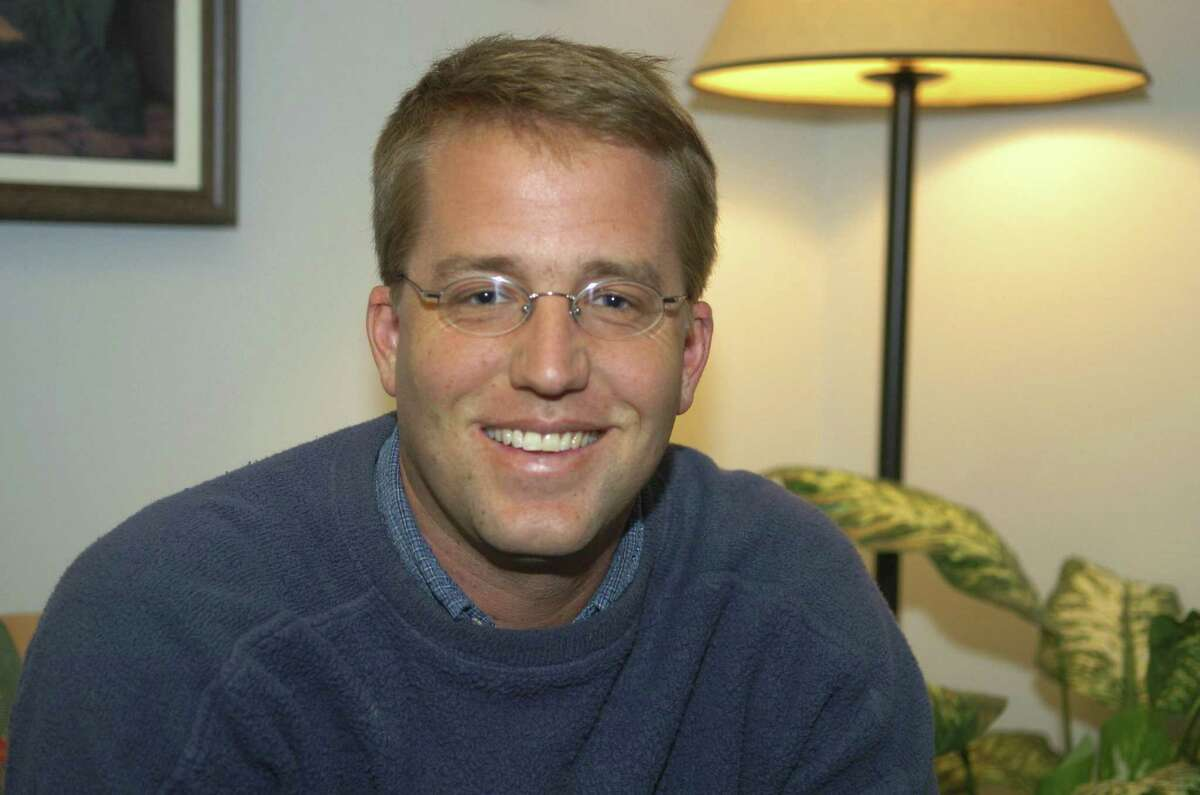 In this 2004 file photo, Fairfield University graduate Douglas Perlitz talks about his missionary work with Haitian street children in a 2004 interview in Fairfield. More than 130 people who say they were sexually abused as children at a now-defunct charity school founded by Perlitz in Haiti have reached a $60 million settlement with a Connecticut Jesuit school and other defendants.