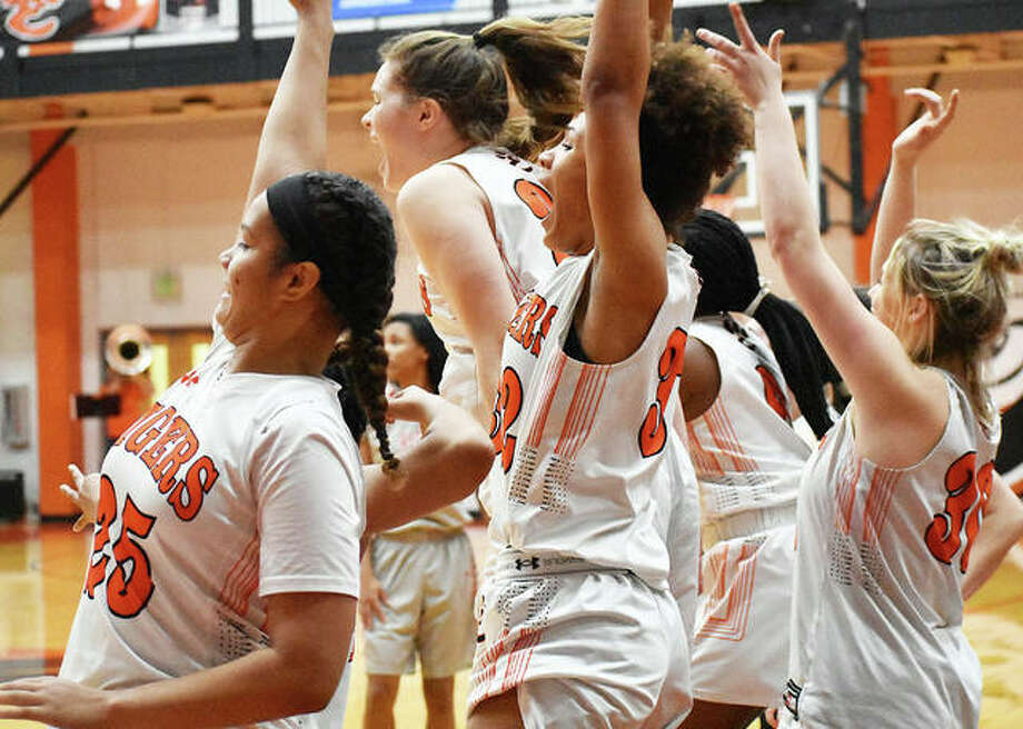 Members of the Edwardsville girls' basketball team celebrate in the closing seconds of a victory over Alton on Thursday. Photo: Matt Kamp/Intelligencer