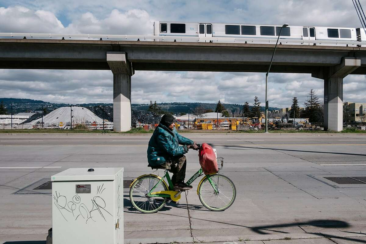 Manuel Gios Miranda rides his bike along San Leandro Street near 66th Avenue in Oakland, Calif., on Monday, February 11, 2019.