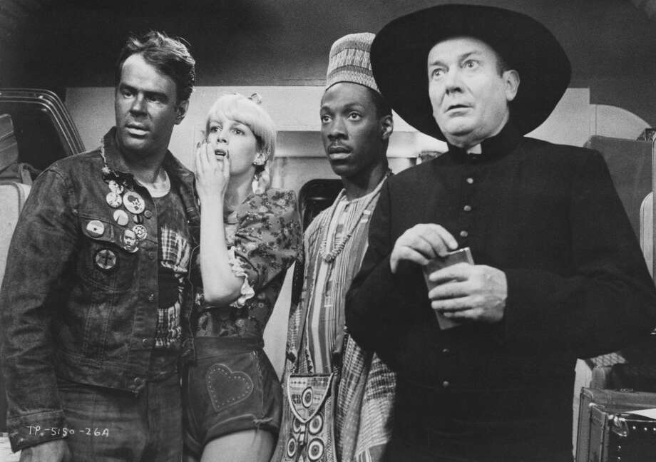 Dan Aykroyd, Jamie Lee Curtis, Eddie Murphy and Denholm Elliott in a scene from 'Trading Places', directed by John Landis, 1983. Photo: Archive Photos/Getty Images