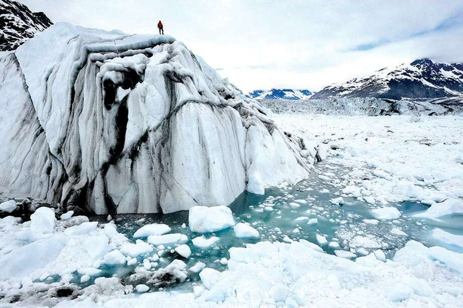 Rapidly melting ice as shown here in the Arctic in 2008 will mean rising sea levels and changing weather patterns. The question isn't whether climate change is real but whether its effects will be bad or catastrophically bad. Photo: James Balog /Associated Press