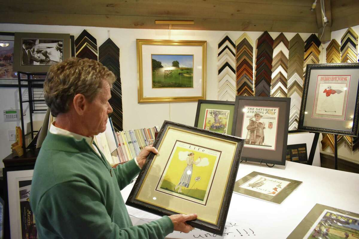Golf Art owner Skip Rooney with a Life framed for sale at his Ridgefield, Conn. shop, in February 2019.