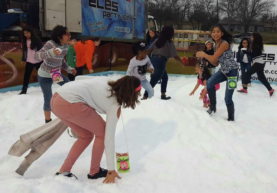Children play in the snow at one of the play areas at last year's Universal City Snowfest. This year's event is set for Saturday at Universal City Park. Photo: Jeff B. Flinn /Staff