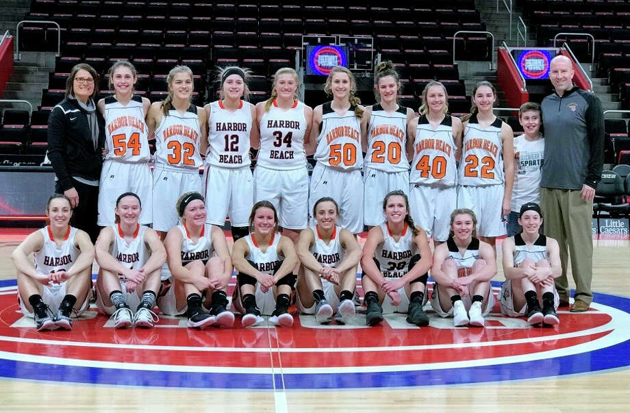 Members of the Harbor Beach varsity and junior varsity teams pose for a picture at center court of Little Caesars Arena, Sunday afternoon. The Pirates defeated Memphis 55-9, making memories that will last a lifetime. (Courtesy Photo)