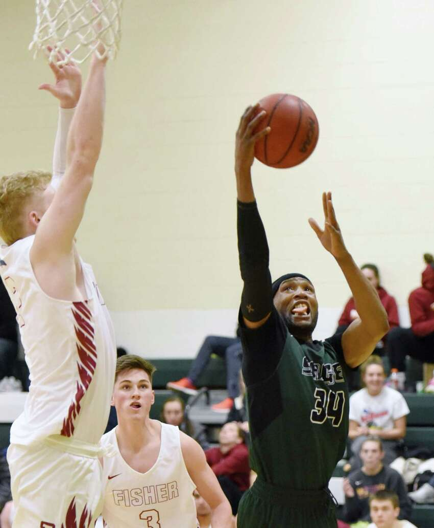 Sage forward Chris Kidd jumps up toward the basket during a game against St. John Fisher Saturday, Feb. 2, 2019 at Sage's Kahl Gymnasium in Albany, NY. (Phoebe Sheehan/Times Union)