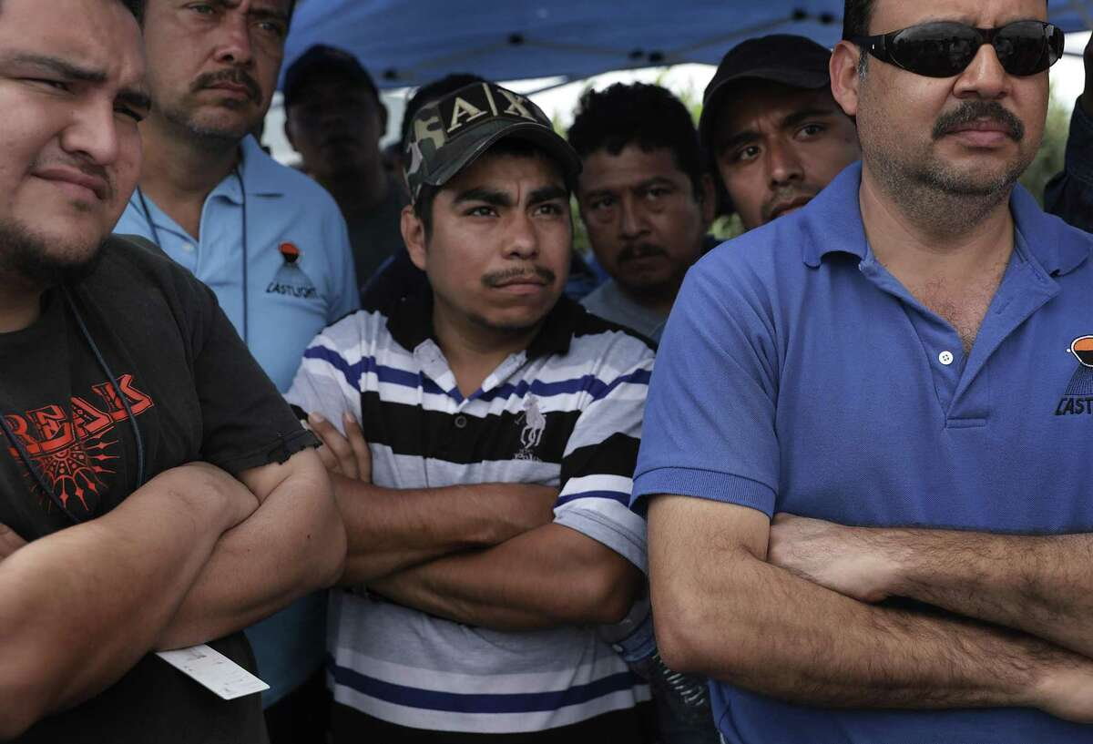 Maquiladora worker Ricardo Medina, center, and many of his co-workers at the Castlight aluminum plant in Matamoros, MX listen to their union leader speak. They have stopped working, protesting for better wages, on Thursday, Feb. 7, 2019.