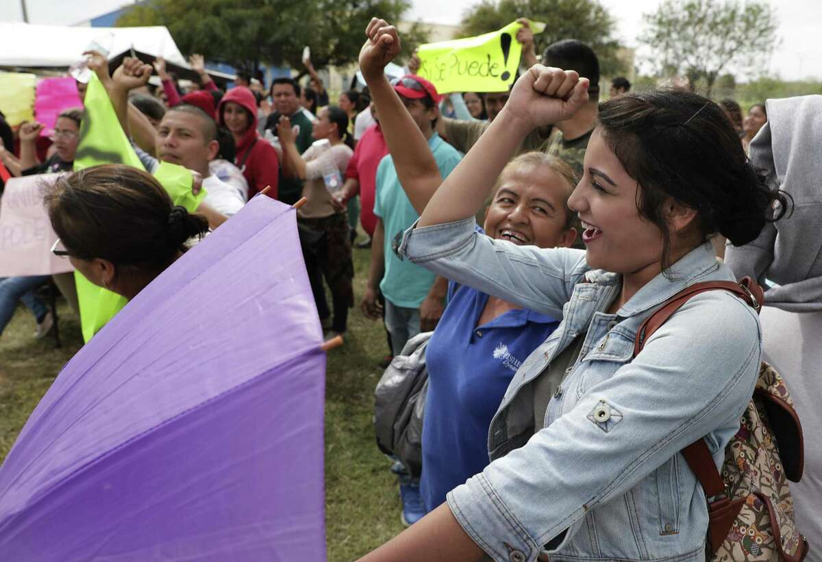 Jaqueline Lopez Guillen, 20, yells a protest chant with co-workers outside Fisher Dynamics, a maquiladora in Matamoros, MX. They have stopped working, protesting for better wages, on Thursday, Feb. 7, 2019.