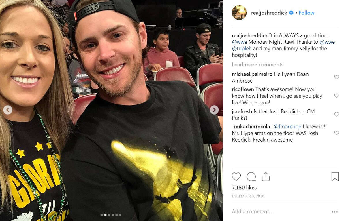 The Astros' Josh Reddick and his fiancee Jett sat ringside for WWE Monday Night Raw in December.