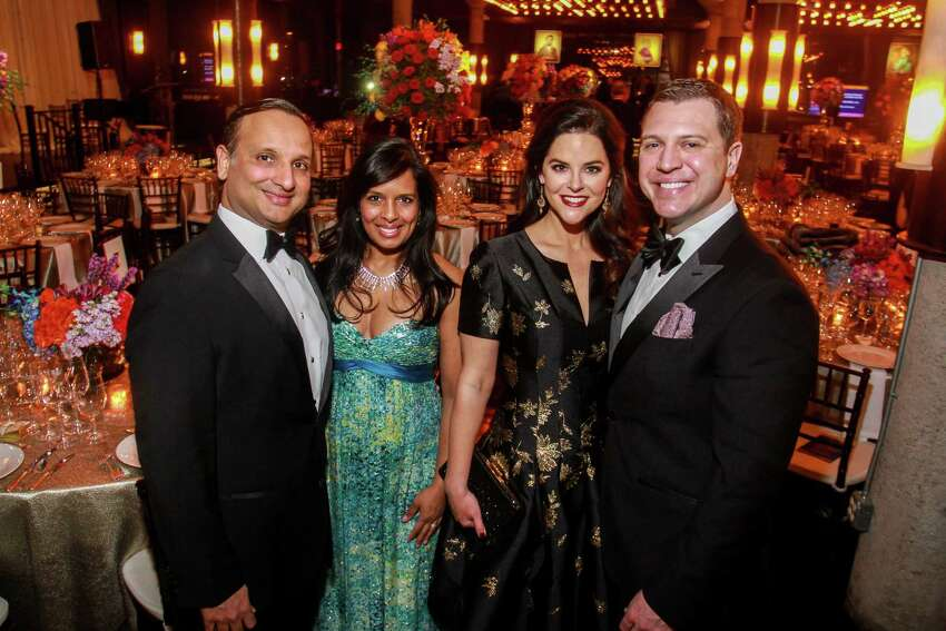 Cody and Kusum Patel, from left, with Ann and Jonathan Ayre at the Houston Symphony's annual Wine Dinner and Collector's Auction at the Astorian.