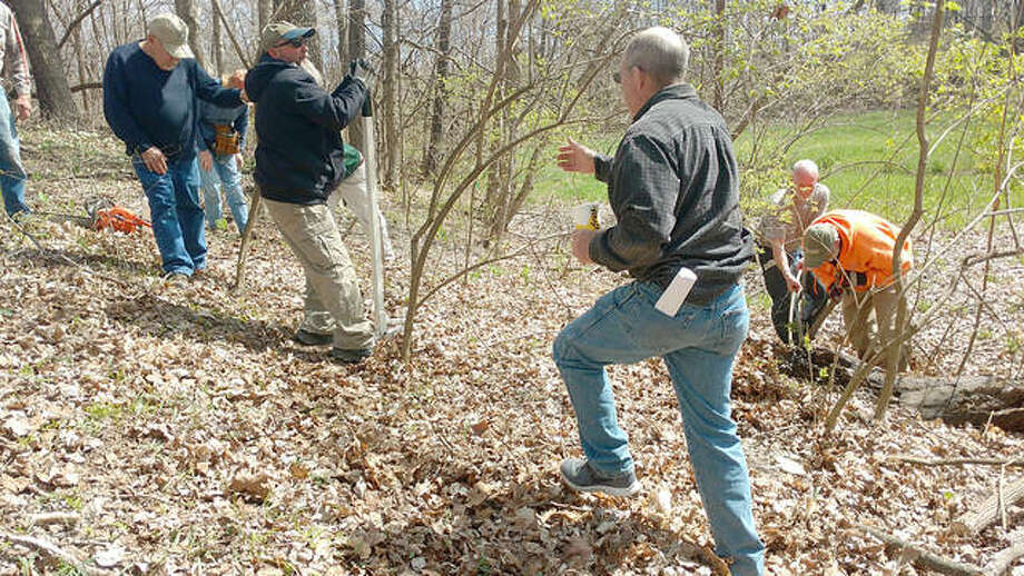 Madison County Prairie Partners demonstrate bush honeysuckle removal at last year's Earth Day event at SIUE Gardens. Photo: For The Intelligencer